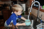 Washing dishes, is one of B's fun games.