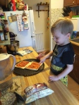 B making pizza. Pepperoni and sauce (hold the cheese)