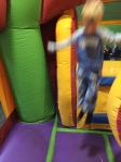 Jumping around at a bouncy house