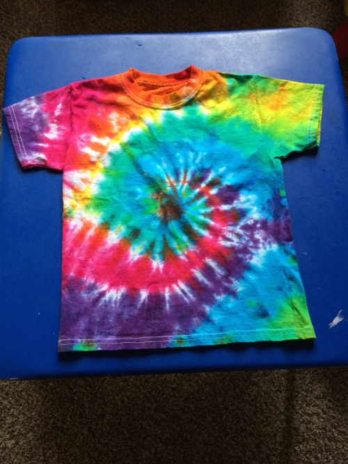 At B's school each grade completes a tie dye of a different color. And the parents are asked to come help make the shirts at school :)