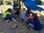 Sand castles at the park with neighbors