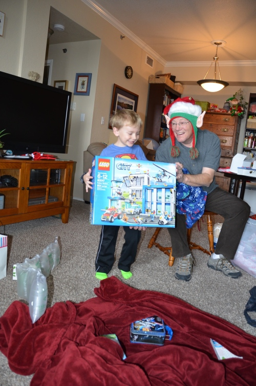 B loves his new Lego set! Mom's friend John is modeling his new fun hat.